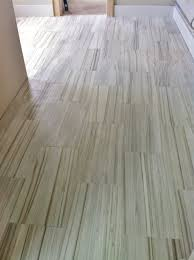 12x24 striated porcelain tile on bathroom floor someone did this