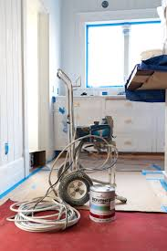is it better to paint or spray kitchen cabinets everything you wanted to about painting with a sprayer