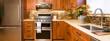 oak kitchen cabinets with stainless steel appliances contemporary upscale kitchen with wood cabinets and