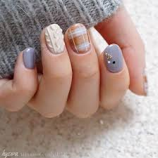 cozy bundle up cozy knitted nail art allows your nails to bundle up in a sweater