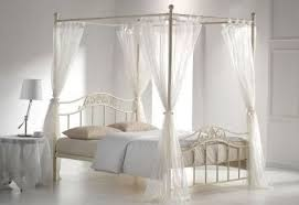 metal silver 4 poster double bed with cream drapes in newport