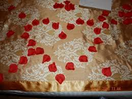 Silk Rose Petals Silk Rose Petals On The Bed With Candles Burning Picture Of