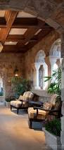 Spanish Houses Rustic Mediterranean Style Coffered Ceiling Veranda Chunky Stone Walls And Archway Rustic