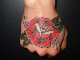 traditional rose tattoo on hand