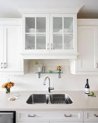 kitchen design cabinets above sink transitional kitchen refined by design kitchen sink