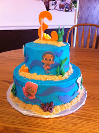 2 tier character cake buttercream frosting w fondant accents and