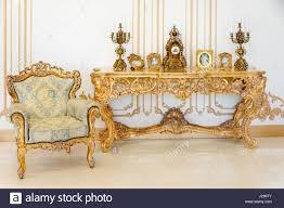 livingroom in luxury livingroom in light colors with golden furniture details