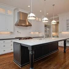 kitchen island cupboards white cabinets with soapstone counters black island with carerra