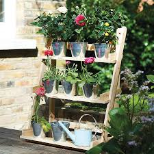 three tier herb and plant theatre with zinc pot set plants