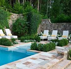 beautiful pool deck and patio area with natural stone tile and