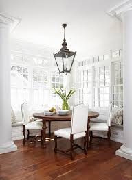Window Seat In Dining Room - elegant dining nook with doric columns and window seat bench by