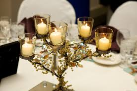 interior white candles in small glass dining table centerpiece