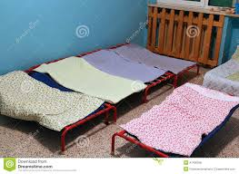 Small Beds by Dormitory With Small Beds For Children In A Preschool Stock Photo