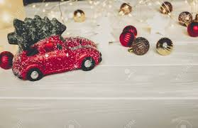 car with tree on top and simple ornaments on