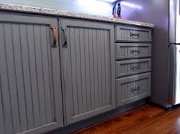 white cabinets transformed to grey blue with weathered distressed