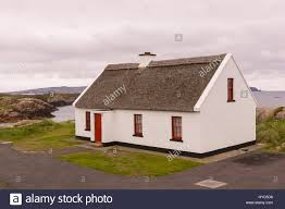 Thatched Cottage Ireland by Cruit Island Donegal Ireland Thatched Roof Cottage Stock Photo