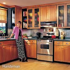 What To Use To Clean Kitchen Cabinets How To Spray Paint Kitchen Cabinets Family Handyman