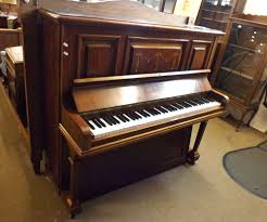 a mahogany cased upright piano by volkner the case with central