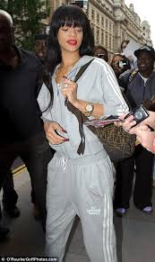 rihanna jumpsuit rihanna covers up in a denim jumpsuit and chunky boots as she