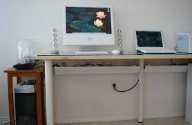 how to organize cables under desk how to hide computer cables on desk remodelaholic how to contain