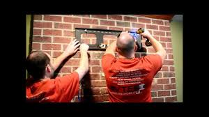 how to hang a flat panel tv on a brick fireplace youtube