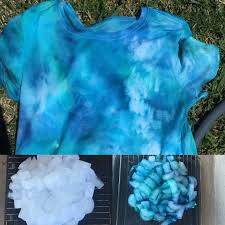 my ice dye shirt 1 crumple shirt on a rack with container under