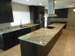 espresso brown shaker cabinets with juparana delicates granite