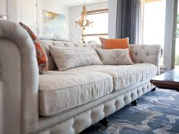 Chesterfield Tufted Sofa by Awesome Tufted Sofa Living Room Using Carved Wood Bun Feet On