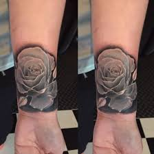 tender 3d realistic rose flower photo like tattoo on wrist with