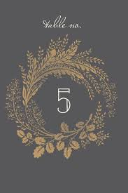 wedding table number fonts woodsy wreath table number featuring naive inline font