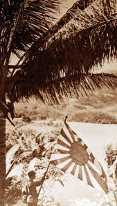 japanese soldier holding japanese flag following invasion and take
