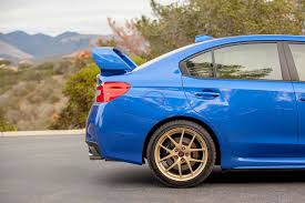 blue subaru gold rims 2015 subaru wrx sti first drive automobile magazine