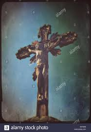 stone sculpture of jesus christ crucified on the cross stock photo