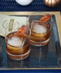maple bourbon cocktail with candied bacon pender peony a