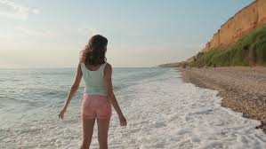 travel girls images Tourist women balancing on rocks walking along beach best friends resiz