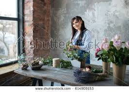 Putting Roses In A Vase Free In Gray Blouse And Jeans Make A Bouquet Over Gray