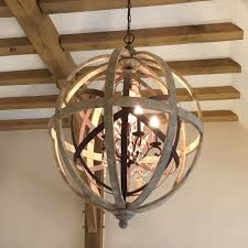 large round wooden orb chandelier with metal orb detail and