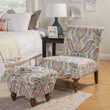 blue brown floral pattern chair combined with cube ottoman having