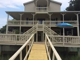 beautiful wraparound porch boat dock water on two sides