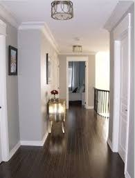 dark floors soft grey wall color and white moulding hallway