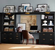 Desk Sets For Home Office Black Built In Shelving And Brass Hardware Gives This Home Office
