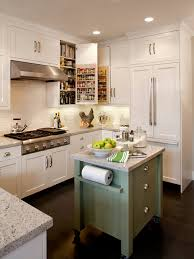 black floor with cute sage green kitchen island and classic white