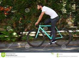 bike riding gear cyclist man riding fixed gear sport bike stock photo image 50149241