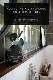 glass shelf between kitchen cabinets how to install a floating shelf on a tile wall without using
