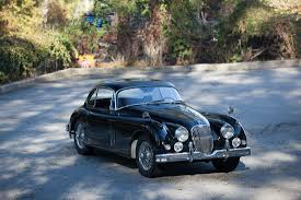 rusty car driving 1958 jaguar xk150
