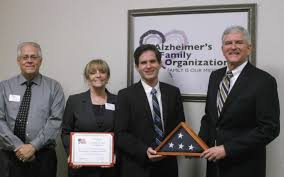 family organization congressman daniel webster presents us flag to alzheimer u0027s family