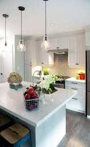 White Kitchen Pendant Lights by Property Brothers Kitchens Light Fixtures Over The Island