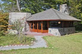 frank lloyd wright style house plans apart from the house is a small guest cottage built in the