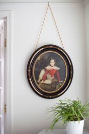 how to hang art from picture rail the makerista