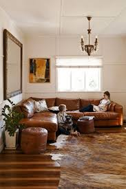 light brown leather corner sofa couch tufted leather sectional brown cowhide rug living room